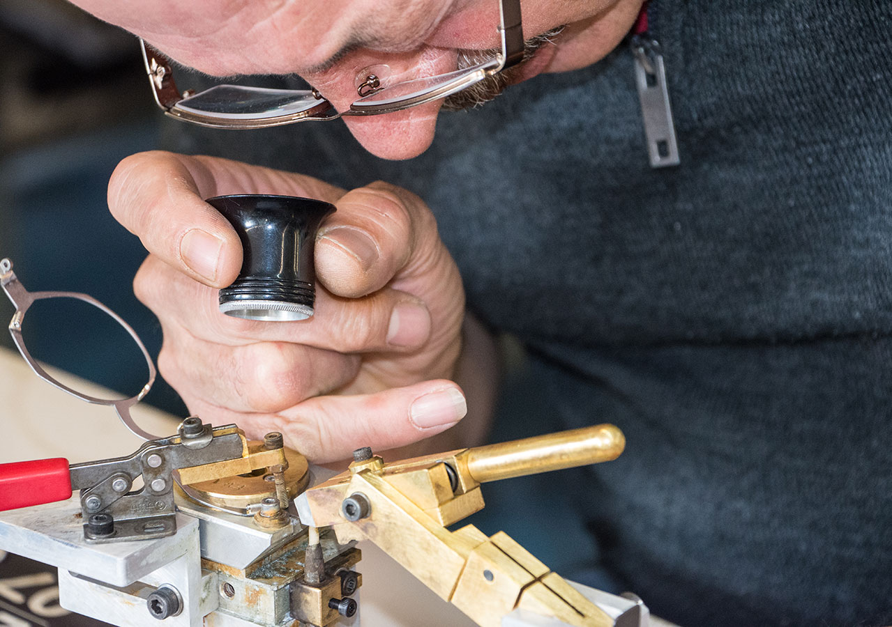 optician working on a pair of glasses